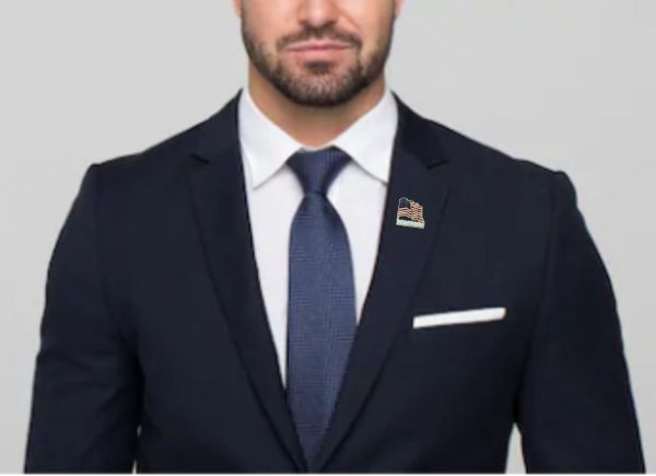 Veteran American Flag Pin being worn on man
